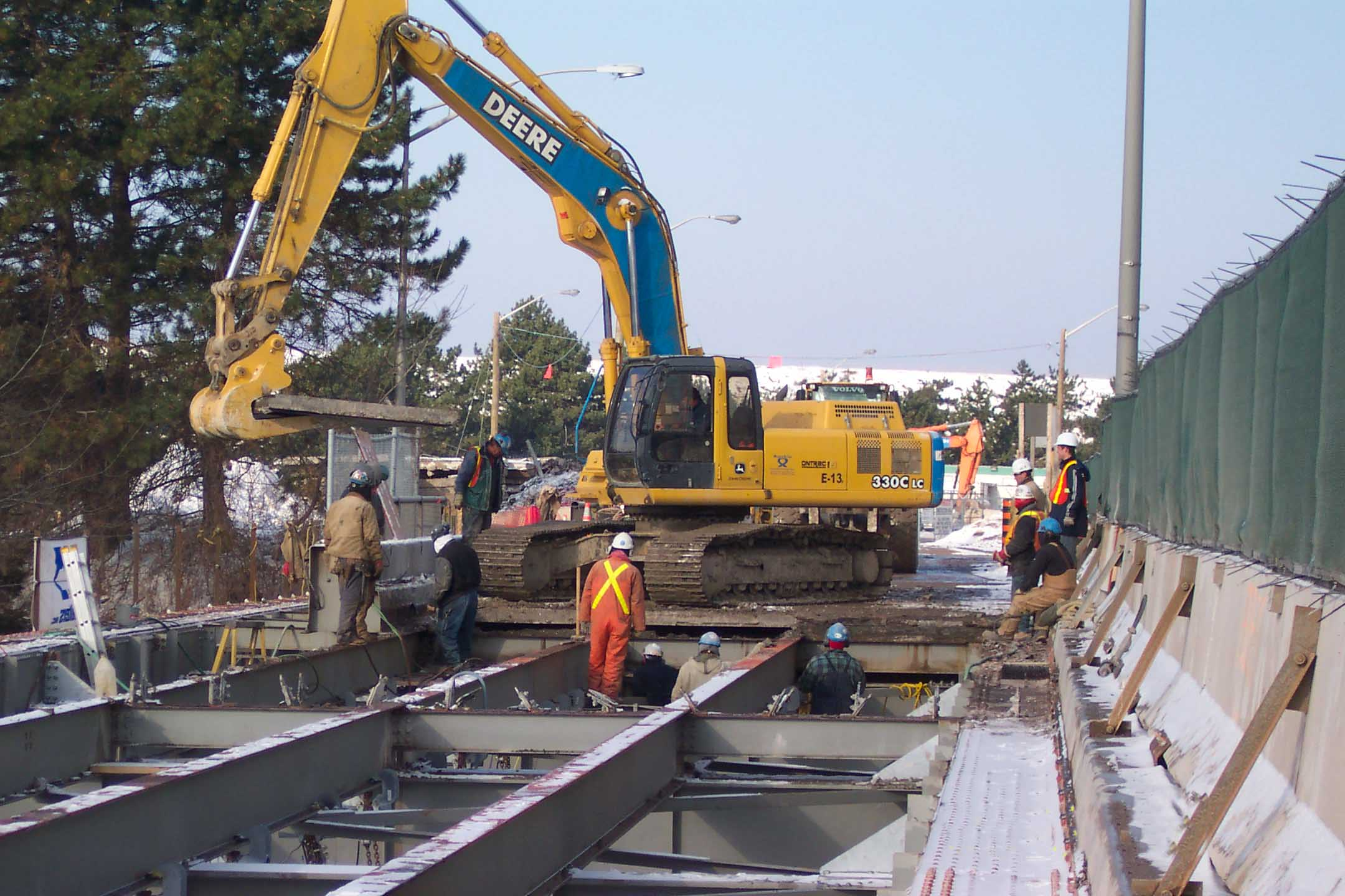 Removal of existing concrete bridge deck.